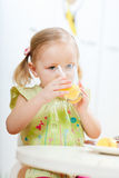 Girl drinking juice Stock Photo