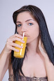 Girl drinking juice Royalty Free Stock Images