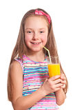 Girl drinking juice Stock Images