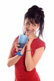 Girl drinking juice. Young attractive brunette girl drinking a juice Royalty Free Stock Photo