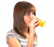 Girl drinking juice. The girl drinking juice on a white background Stock Photos