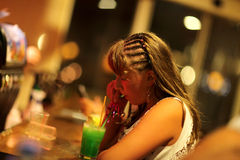 Girl drinking juice in bar Stock Image