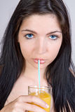 Girl drinking juice Royalty Free Stock Photos