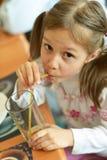 Girl drinking juice Stock Photography