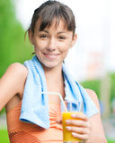 Girl drinking juice after exercise Stock Images