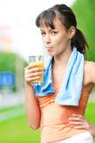 Girl drinking juice after exercise Stock Photography