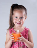 Girl drinking juice Royalty Free Stock Image