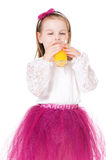 Girl drinking juice stock photo