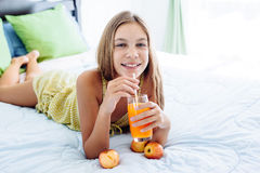 Girl drinking juice and relaxing in bedroom Royalty Free Stock Photography