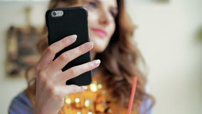 Girl drinking latte, speaking on the phone, using notebook. Zoom stock video footage