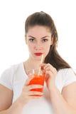 Girl drinking lemonade Stock Images