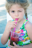 Girl drinking. Little girl drinking refreshing drink stock photography