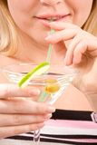 Girl drinking Martini cocktail Stock Photos