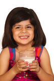 Girl drinking milk. Beautiful little girl drinking milk stock images