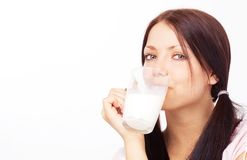 Girl drinking milk Royalty Free Stock Photography