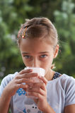 Girl drinking milk Royalty Free Stock Image