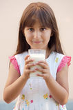 Girl drinking milk Stock Image