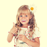 Girl drinking milk from glass Royalty Free Stock Images