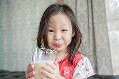 Girl drinking milk from glass Stock Photos