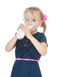 Girl drinking milk from a large glass Stock Photography