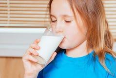 Girl is drinking milk Stock Photo