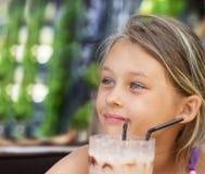 Girl is drinking a milkshake Royalty Free Stock Photos