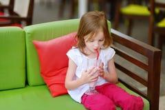 A girl drinking milkshake in outdoor restaurant Stock Photography