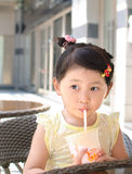 Girl drinking milky tea Stock Photos