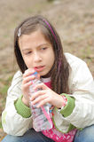 Girl drinking mineral water Royalty Free Stock Photo