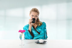 Girl drinking morning coffee Royalty Free Stock Photos