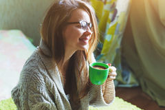 Girl drinking morning coffee in bed Stock Photos