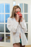 Girl drinking morning coffee Stock Image