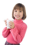 Girl drinking from a mug Royalty Free Stock Photo