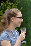 Girl drinking nonalcoholic cocktail. Teenage girl with long blond hair  drinking nonalcoholic cocktail Royalty Free Stock Images