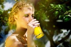 Girl drinking orange juice Royalty Free Stock Photos