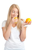 Girl drinking orange juice Royalty Free Stock Image