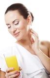 Girl drinking orange juice Royalty Free Stock Images