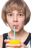 Girl drinking orange juice Stock Photos