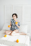 Girl drinking orange juice at Breakfast in bed. Young beautiful girl drinking orange juice at Breakfast in bed in the morning Stock Photos