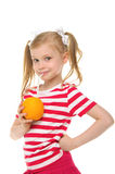 Girl drinking orange juice through straw Royalty Free Stock Images