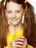 Girl Drinking Orange Juice Stock Photos