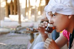 Girl drinking orient tea Stock Photography