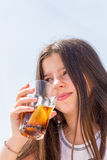 Girl drinking royalty free stock photo