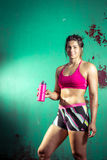 Girl drinking protiein shake after training Stock Images
