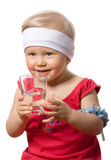 The girl is drinking pure spring water. On a white background Royalty Free Stock Photography