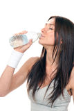 Girl drinking pure water from a bottle Royalty Free Stock Photography