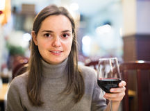 Girl drinking red wine at cafe Royalty Free Stock Images