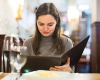 Girl drinking red wine at cafe Stock Photo
