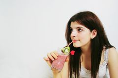 Girl drinking smoothie Royalty Free Stock Photo