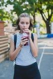 Girl drinking smoothie Royalty Free Stock Photos